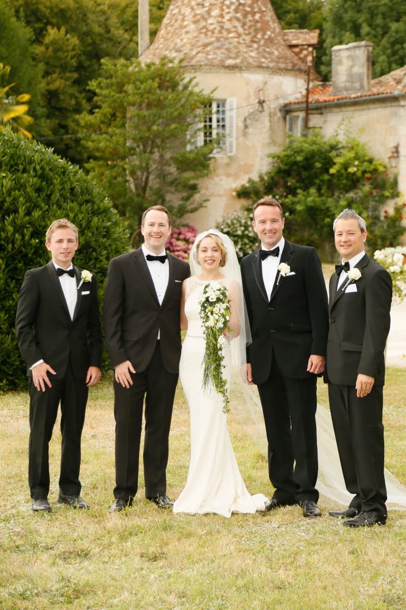Bride, groom and groomsmen at a wedding in Chateau de Puyrigaud