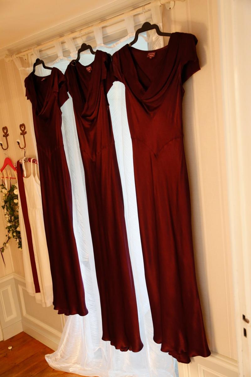 Wedding in France: Ghost Sylvia burgundy bridesmaids dresses hanging on hanger