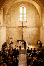 Wedding guests at a wedding in France in an 11th Century church