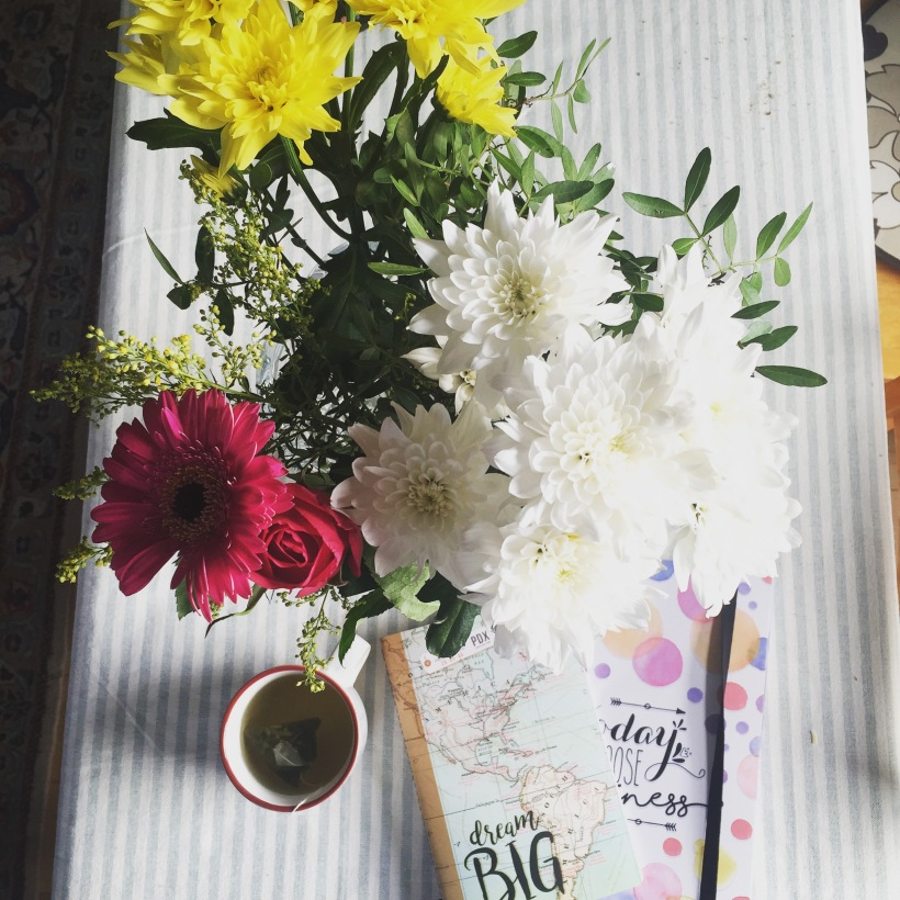 Flowers and notebook setting goals