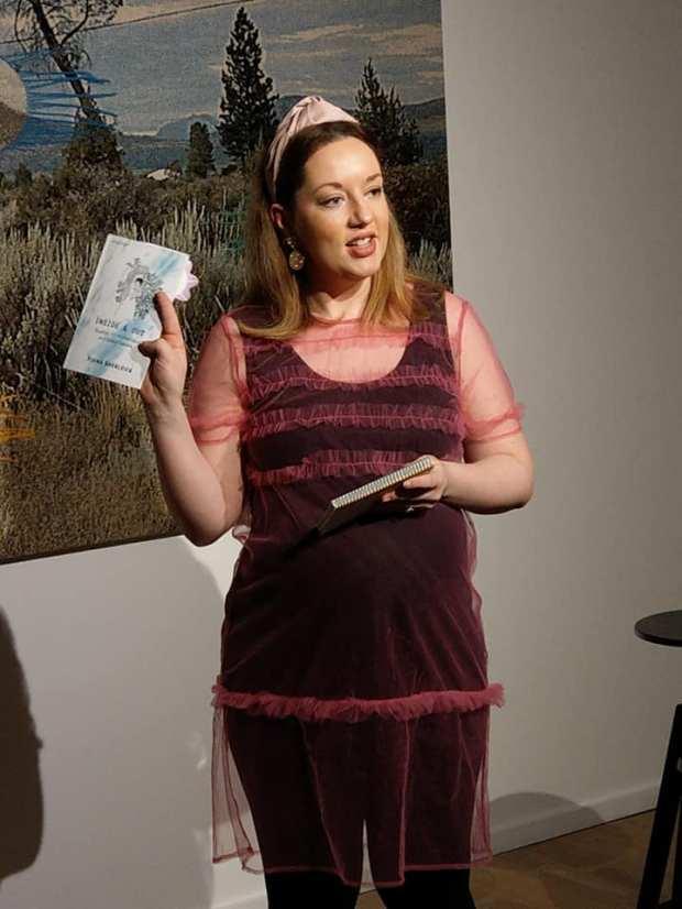 Fiona Sherlock holding her Book Launch Solstice Navan